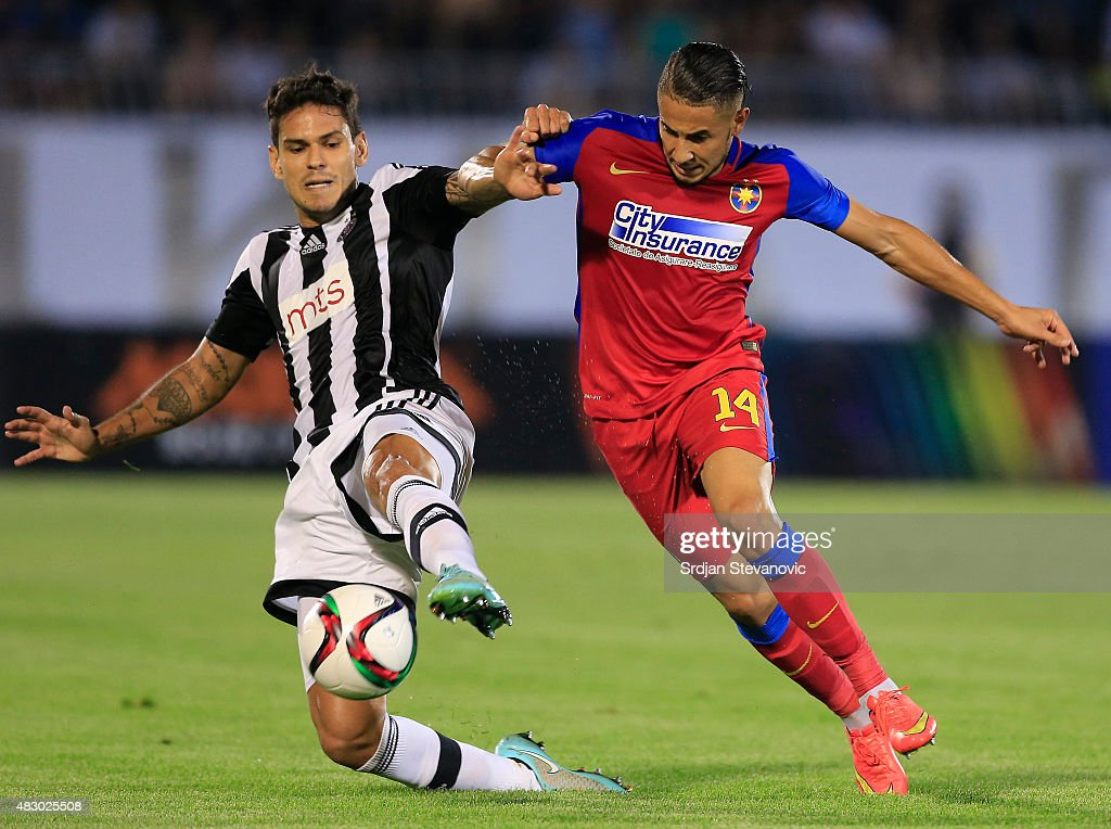Jugurtha Hamroun (R) of FC Steaua Bucharest in action against Fabricio (L) of FC Partizan Belgrade during the UEFA Champions League Third Qualifying Round Second Leg match between FC Partizan Belgrade and FC Steaua Bucharest at FC Partizan stadium in Belgrade, Serbia on Wednesday, August 05, 2015.