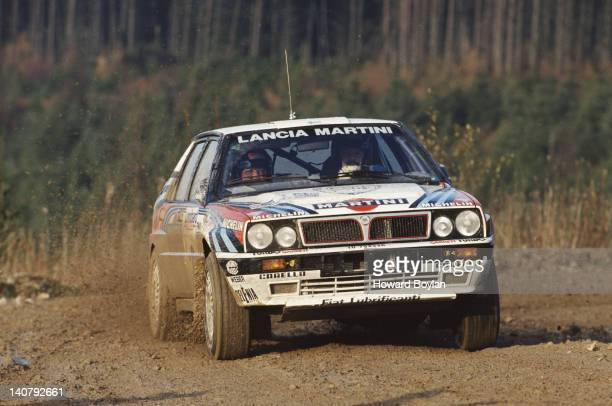 Juha Kankkunen and co driver navigator Juha Piironen of Finland driving the Martini Lancia Delta HF Integrale 16v during the FIA World Rally...