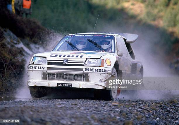 Juha Kankkunen and Juha Piironen of Finland driving a Peugeot 205 Turbo 16 during the Lombard RAC Rally circa 1986