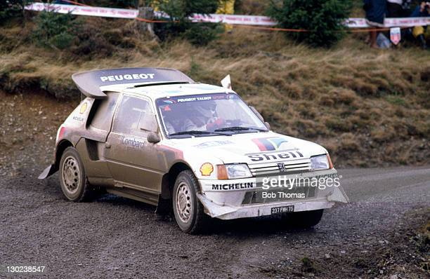 Juha Kankkunen and Juha Piironen of Finland driving a Peugeot 205 Turbo during the Lombard RAC Rally circa 1986