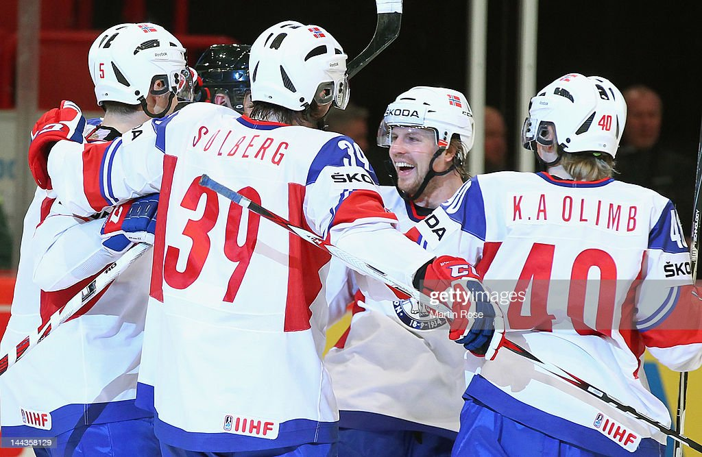 Juha Kaunismaki (C) of Norway celebrate during the IIHF World Championship group S match between Germany and Norway at Ericsson Globe on May 13, 2012 in Stockholm, Sweden.