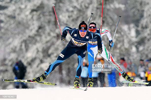 Juha Lallukka of Finland and Roland Clara of Italy compete in the Men's Cross Country 4x10km Relay race during the FIS Nordic World Ski Championships...