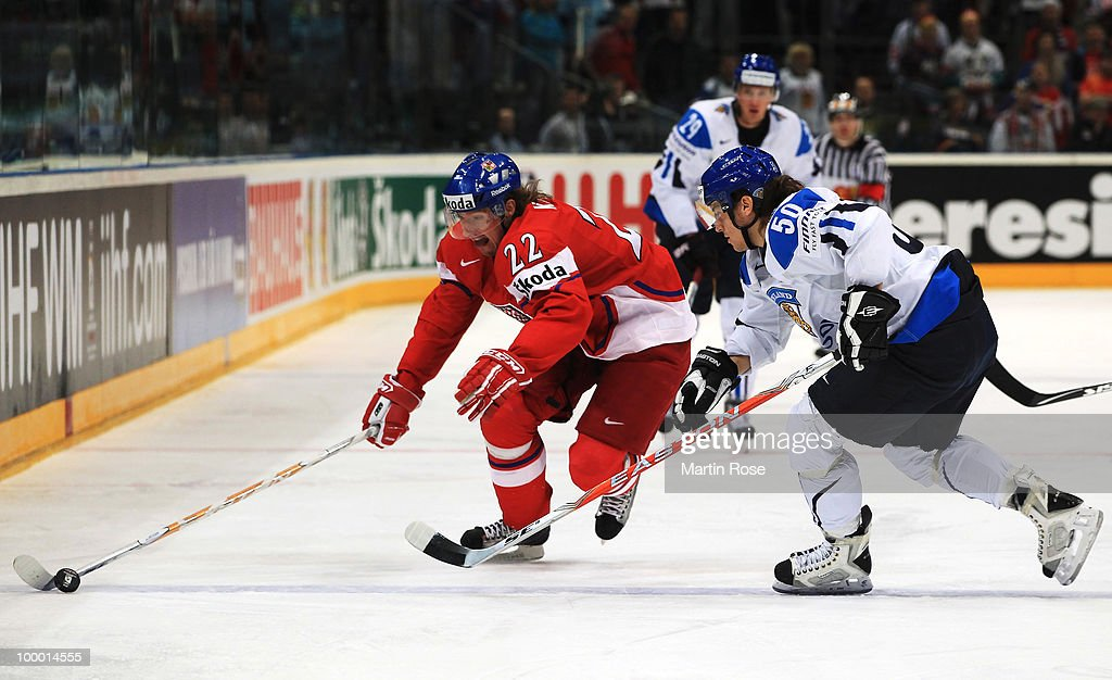 Juhamatti Aaltonen (R) of Finland and Lukas Kaspar (L) of Czech Republic battle for the puck during the IIHF World Championship quarter final match between Finland and Czech Republic at Lanxess Arena on May 20, 2010 in Cologne, Germany.