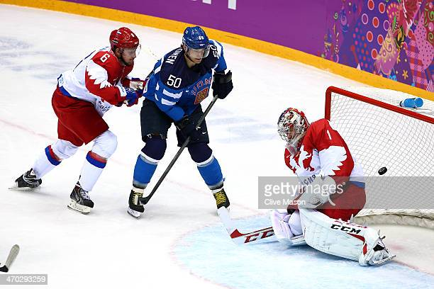 Juhamatti Aaltonen of Finland scores a firstperiod goal against Semyon Varlamov of Russia as Nikita Nikitin of Russia defends during the Men's Ice...