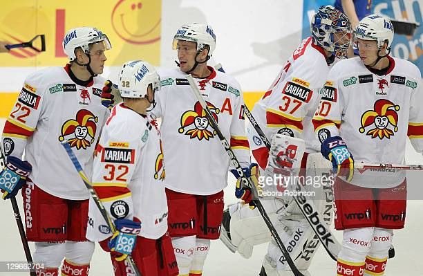 Juhani Tyrvainen, Riku Hahl; Antti-Jussi Niemi, Eero Kilpelainen and Tommy Kivisto of Jokerit Helsinki gather together during the game against the...