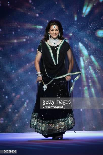 Juhi Chawla walks the runway in a Kaya Jewellery design at the India International Jewellery Week 2012 Day 3 at the Grand Hyatt on on August 21, 2012...