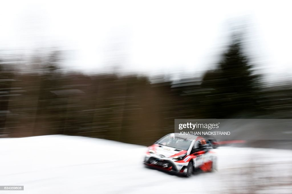 TOPSHOT - Juho Hanninen of Finland and his co-driver Kaj Lindstrom steer their Toyota Yaris WRC during the Shakedown of the Rally Sweden, second round of the FIA World Rally Championship on February 9, 2017 near Torsby, Sweden. / AFP PHOTO / Jonathan NACKSTRAND