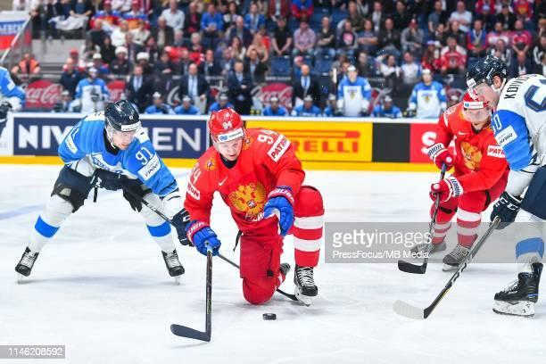 Juho Lammikko of Finland tackles Alexander Barabanov of Russia during the 2019 IIHF Ice Hockey World Championship Slovakia semi final game between...