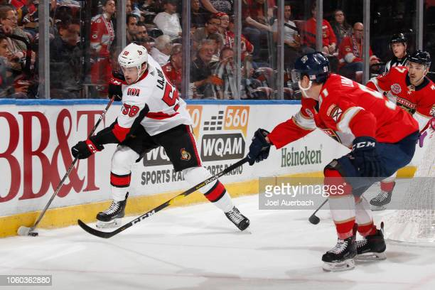 Juho Lammikko of the Florida Panthers attampts to take the puck from Maxime Lajoie of the Ottawa Senators during first period action at the BB&T...
