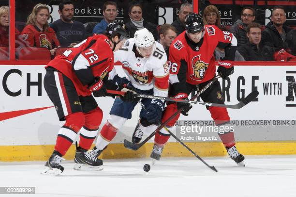 Juho Lammikko of the Florida Panthers battles for puck possession against Thomas Chabot and Colin White of the Ottawa Senators at Canadian Tire...