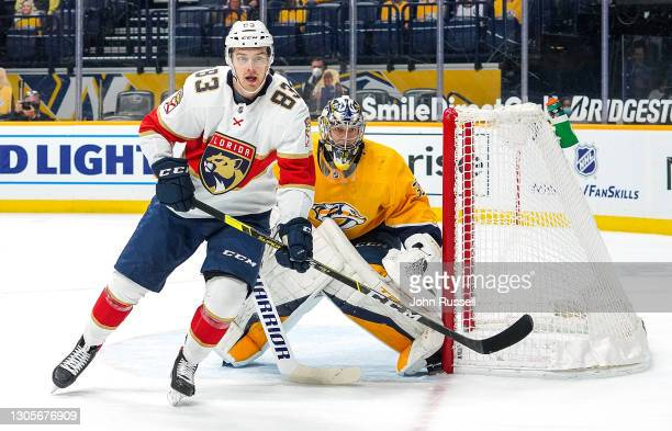 Juho Lammikko of the Florida Panthers battles in front of the net against Pekka Rinne of the Nashville Predators at Bridgestone Arena on March 4,...