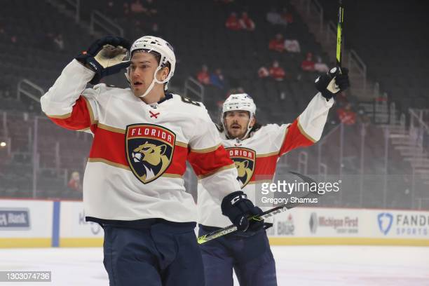 Juho Lammikko of the Florida Panthers celebrates his first period goal in front of teammate MacKenzie Weegar while playing the Detroit Red Wings at...