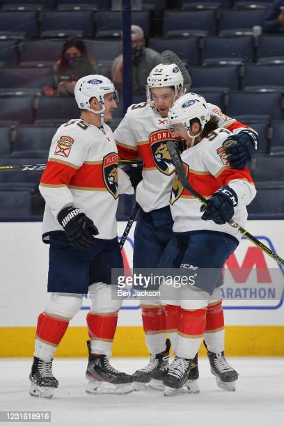 Juho Lammikko of the Florida Panthers celebrates his first period goal with teammates Noel Acciari and Ryan Lomberg of the Florida Panthers during a...