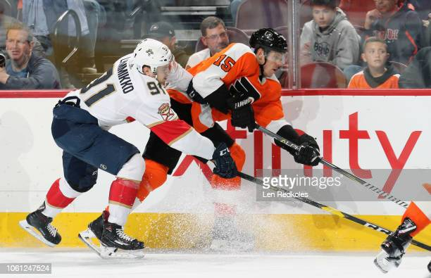 Juho Lammikko of the Florida Panthers collides along the boards with Jori Lehtera of the Philadelphia Flyers on November 13, 2018 at the Wells Fargo...