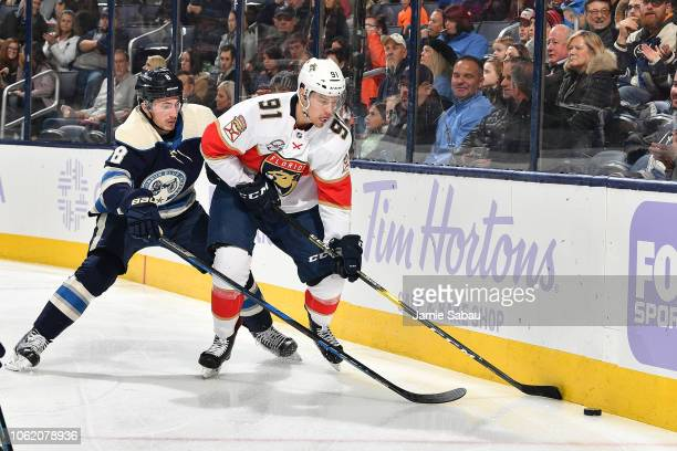 Juho Lammikko of the Florida Panthers shields the puck from Zach Werenski of the Columbus Blue Jackets during the second period of a game on November...