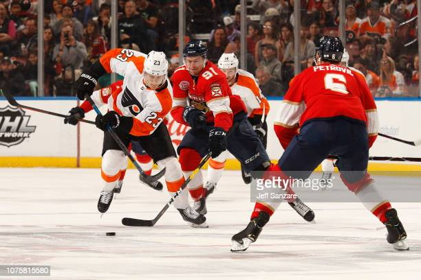 Juho Lammikko of the Florida Panthers skates for possession against Oskar Lindblom of the Philadelphia Flyers at the BB&T Center on December 29, 2018...