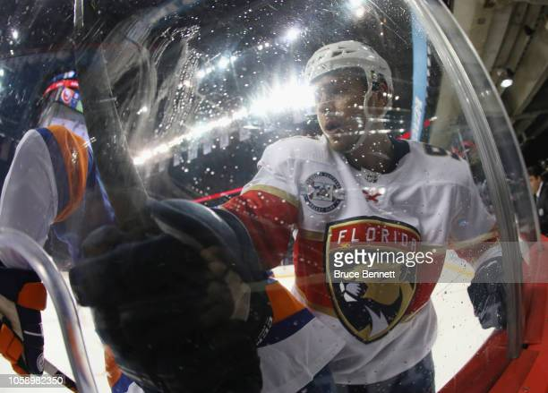 Juho Lammikko of the Florida Panthers works the boards against the New York Islanders at the Barclays Center on October 24, 2018 in the Brooklyn...