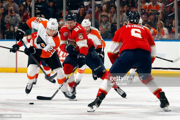 Juho Lammikko of the Panthers crosses sticks with Brandon Manning of the Philadelphia Flyers at the BB&T Center on December 29, 2018 in Sunrise,...