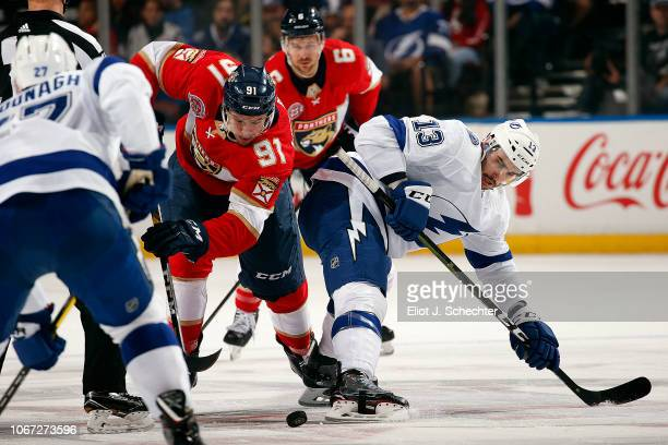 Juho Lammikko of the Panthers faces off against Cedric Paquette of the Tampa Bay Lightning at the BB&T Center on December 1, 2018 in Sunrise, Florida.