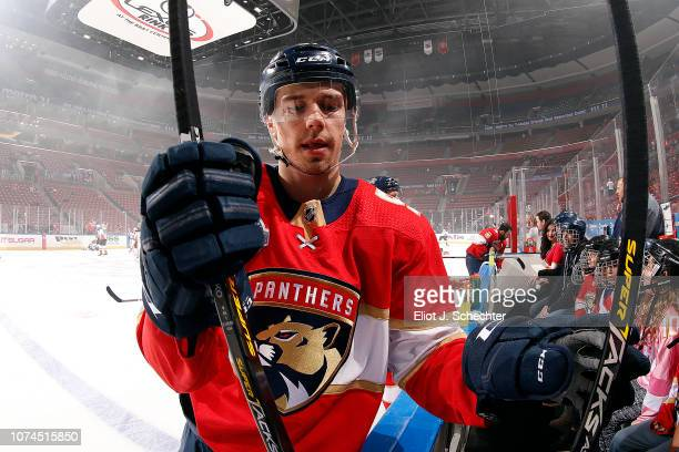 Juho Lammikko of the Panthers picks out a stick during warm ups prior to the start of their game against the Anaheim Ducks at the BB&T Center on...