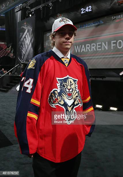 Juho Lammikko walks to meet his team after being drafted by the Florida Panthers on Day Two of the 2014 NHL Draft at the Wells Fargo Center on June...