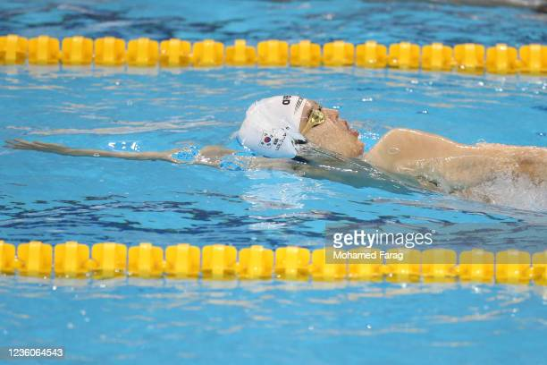 Juho Lee of South Korea competes in the Men's 100m Individual Backstroke Heats during day Three of the FINA Swimming World Cup Doha at Hamad Aquatic...