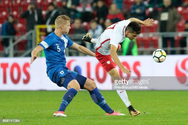 Juho Pirttijoki of Finland and Bartosz Kapustka of Poland during the 2019 UEFA European Under21 Championship qualification game between Poland and...