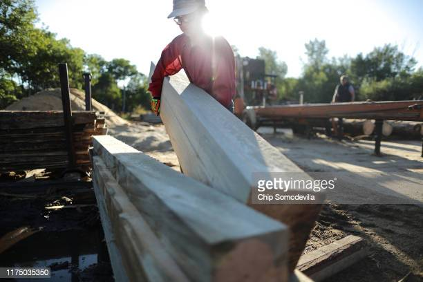 Juice Custom Cutting employee Dylan Lewis pulls and stack boards cut from mountain pine beetlekilled trees at the outdoor saw mill September 12 2019...