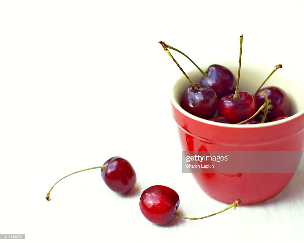 Juicy Cherries In Red Kitchen Pot Stock Photo | Getty Images