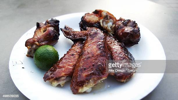 Juicy chicken wings served in plate