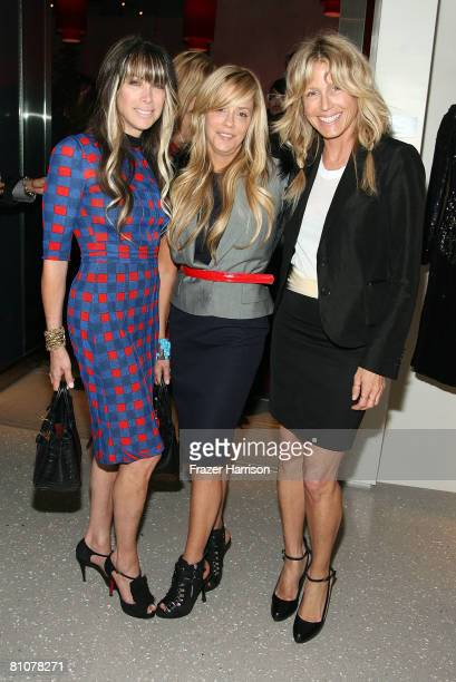 Juicy Couture's cofounders copresidents codesigners Gela NashTaylor and Pamela SkaistLevy and designer Tracey Ross pose during the Alexander McQueen...