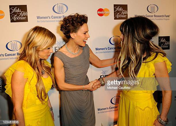 Juicy Couture's co-founders, co-presidents, co-designers Pamela Skaist-Levy and Gela Nash-Taylor pose with actress Hilary Swank at the Saks Fifth...