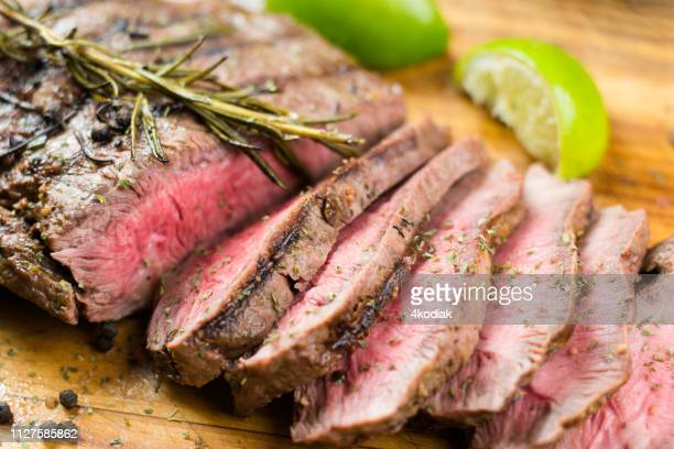 juicy grilled flank steak - beef stock pictures, royalty-free photos & images