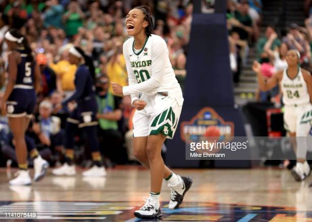 Juicy Landrum of the Baylor Lady Bears celebrates the play against the Notre Dame Fighting Irish during the first quarter in the championship game of...