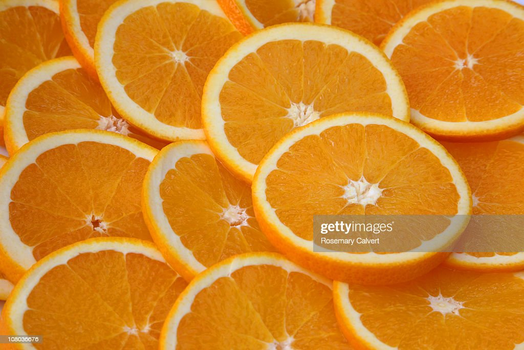 Juicy orange slices filling frame. : Stock Photo
