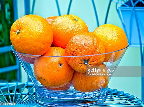 juicy oranges in glass bowl - chelsea flower show stock pictures, royalty-free photos & images
