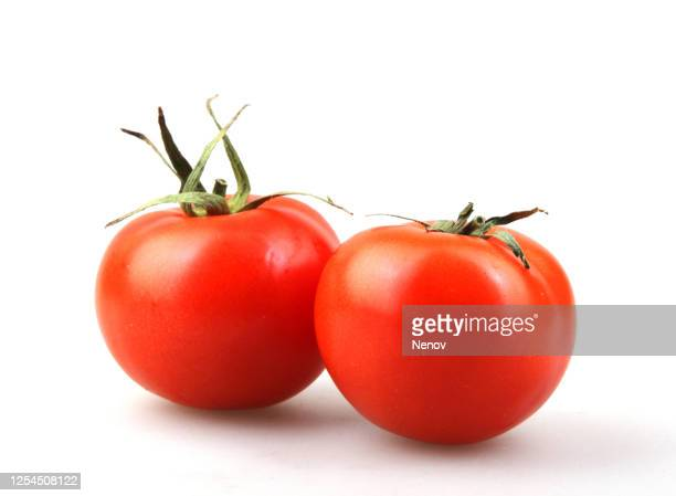 juicy red tomatoes isolated on white background - トマト ストックフォトと画像