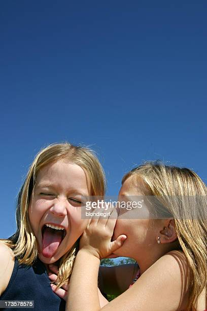 juicy secret - little girl sticking out tongue stock photos and pictures