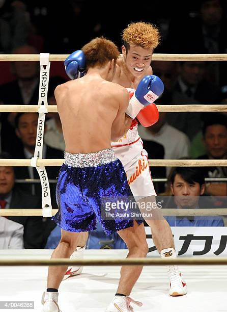 Juiki Tatsuyoshi hits his right on Tadao Iwaya during the WBC Super Bantamweight fourth round bout at BodyMaker Colosseum on April 16 2015 in Osaka...