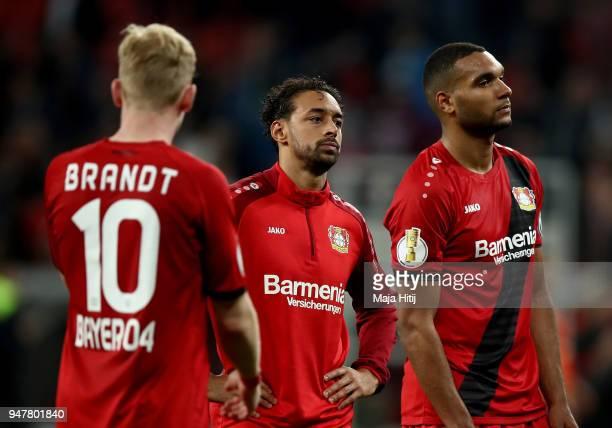 Juilan Brandt Karim Bellarabi and Jonathan Tah of Leverkusen look dejected after the DFB Cup semi final match between Bayer 04 Leverkusen and Bayern...