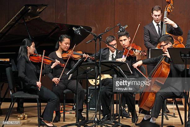 """Juilliard Jazz Ensemble performing the music of Israel """"Cachao"""" Lopez at Paul Hall on March 30, 2015.This image:From left, Johnna Wu, Isabel Ong,..."""