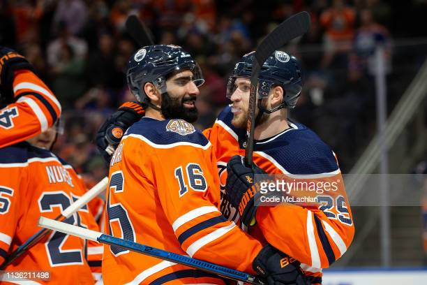 Jujhar Khaira and Leon Draisaitl of the Edmonton Oilers celebrate their victory against the New York Rangers during the third period at Rogers Place...