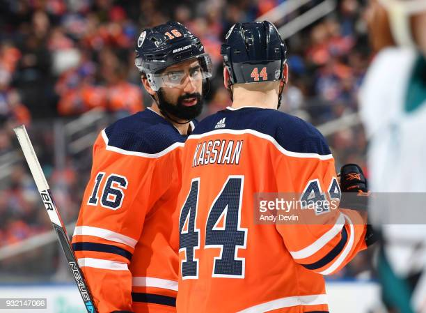Jujhar Khaira and Zack Kassian of the Edmonton Oilers discuss the play during the game against the San Jose Sharks on March 14 2018 at Rogers Place...