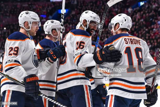 Jujhar Khaira of the Edmonton Oilers celebrates his first period goal with teammates Ryan Strome and Leon Draisaitl against the Montreal Canadiens...