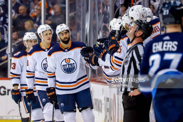 Jujhar Khaira of the Edmonton Oilers celebrates his second period goal against the Winnipeg Jets with teammates at the bench at the Bell MTS Place on...