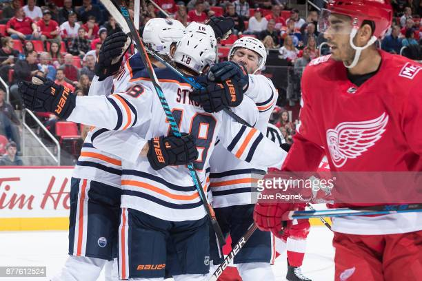 Jujhar Khaira of the Edmonton Oilers celebrates his second period goal with teammates Ryan Strome and Yohann Auvitu as Trevor Daley of the Detroit...
