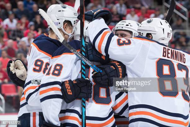 Jujhar Khaira of the Edmonton Oilers celebrates his second period goal with teammates Ryan Strome Yohann Auvitu Jesse Puljujarvi and Matthew Benning...