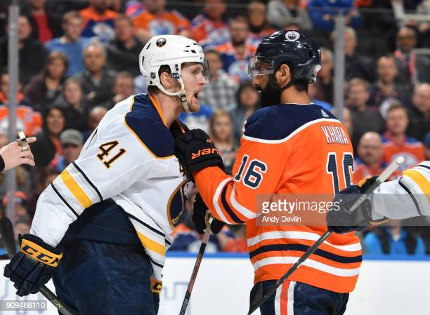 Jujhar Khaira of the Edmonton Oilers exchanges words with Justin Falk of the Buffalo Sabres on January 23 2017 at Rogers Place in Edmonton Alberta...