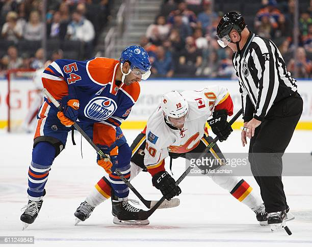 Jujhar Khaira of the Edmonton Oilers faces off against Linden Vey of the Calgary Flames on September 26 2016 at Rogers Place in Edmonton Alberta...