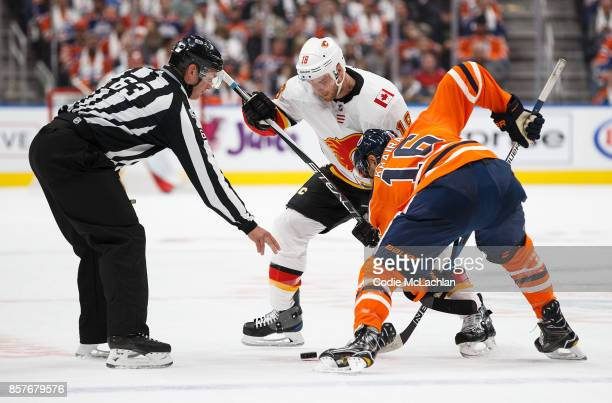 Jujhar Khaira of the Edmonton Oilers faces off against Matt Stajan of the Calgary Flames in the season opener at Rogers Place on October 4 2017 in...